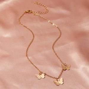 FREE W/ $25+ PURCHASE gold butterfly necklace
